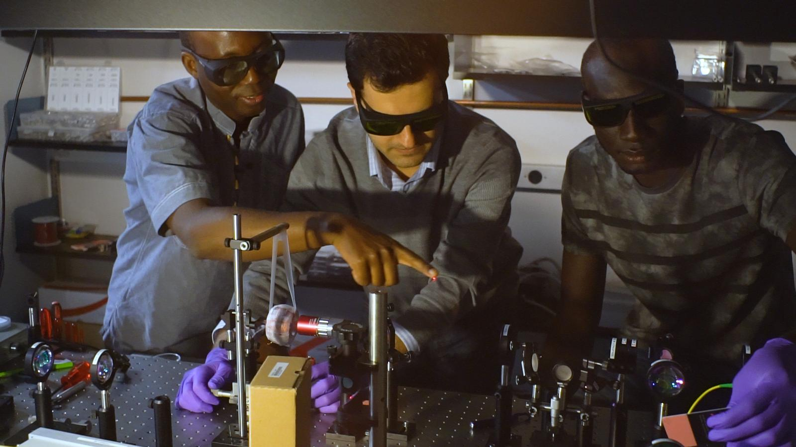 Left to right: UC San Diego electrical engineering professor Boubacar Kante and team members Babak Bahari and Abdoulaye Ndao have demonstrated the first topological cavity