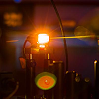 Flash of Light in Research Expo Artwork Comes from a Supercontinuum Laser Source